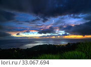 Sunset with dramatic rain clouds during hurricane season. Dominica, West Indies. September 2019. Стоковое фото, фотограф Derek Galon / Nature Picture Library / Фотобанк Лори