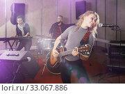 Купить «Fine guitar player and singer with band», фото № 33067886, снято 26 октября 2018 г. (c) Яков Филимонов / Фотобанк Лори