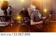 Купить «Merry guitar player and singer with band», фото № 33067890, снято 26 октября 2018 г. (c) Яков Филимонов / Фотобанк Лори