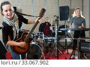 Купить «Young girl guitar player and singer with band», фото № 33067902, снято 26 октября 2018 г. (c) Яков Филимонов / Фотобанк Лори