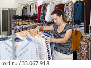 Купить «Woman shopping in clothing boutique», фото № 33067918, снято 10 октября 2018 г. (c) Яков Филимонов / Фотобанк Лори