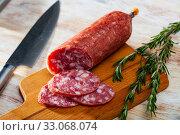 Купить «Appetizing salchichon sausage on wooden table», фото № 33068074, снято 9 июля 2020 г. (c) Яков Филимонов / Фотобанк Лори