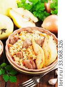 Купить «Pilaf with meat and quince», фото № 33068326, снято 13 ноября 2019 г. (c) Надежда Мишкова / Фотобанк Лори