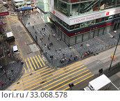 Купить «Pedestrian crossing, top view from Chungking Mansions, Hong Kong», фото № 33068578, снято 15 сентября 2017 г. (c) Александр Подшивалов / Фотобанк Лори
