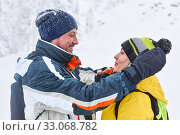 Couple of travelers look at each other, hugging on the background of a blurry winter landscape. Стоковое фото, фотограф Евгений Харитонов / Фотобанк Лори