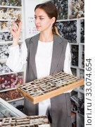Купить «Woman choosing buttons in shop», фото № 33074654, снято 18 октября 2019 г. (c) Яков Филимонов / Фотобанк Лори