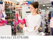 Купить «Woman choosing colorful ribbons», фото № 33074686, снято 18 октября 2019 г. (c) Яков Филимонов / Фотобанк Лори