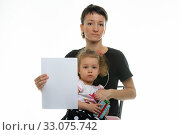 Mom and baby sit on a chair and hold a white sheet in their hands. Стоковое фото, фотограф Иванов Алексей / Фотобанк Лори