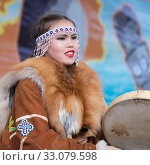 Girl dancing with tambourine in tradition clothing aborigine people Kamchatka Peninsula. Celebration Koryak national ritual holiday Day of Seal - Hololo. Kamchatka, Russia (2018 год). Редакционное фото, фотограф А. А. Пирагис / Фотобанк Лори
