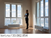 Купить «The realtor is still waiting for buyers to look out the window», фото № 33082854, снято 3 ноября 2019 г. (c) Иванов Алексей / Фотобанк Лори