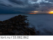 Купить «Night view of the rocky shore of the Black Sea, Anapa, Russia», фото № 33082862, снято 12 февраля 2020 г. (c) Иванов Алексей / Фотобанк Лори