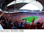 Купить «LONDON - APRIL 14 : Supporters watch the football game of Liverpool - Everton Semi Final FA Cup Crowd at Wembley Arena Staduim on April 14, 2012 in London, England United Kingdom.», фото № 33091990, снято 14 апреля 2012 г. (c) age Fotostock / Фотобанк Лори