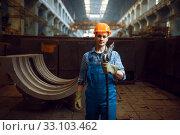 Купить «Male worker holds pneumatic jackhammer on factory», фото № 33103462, снято 31 января 2020 г. (c) Tryapitsyn Sergiy / Фотобанк Лори