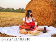 The girl on a mow with a basket of bread and a jug of milk. Стоковое фото, фотограф Арестов Андрей Павлович / Фотобанк Лори