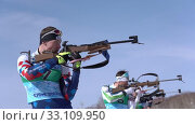 Купить «Junior biathlon competitions East of Cup. Sportsman biathlete aiming, rifle shooting and reloading in standing position. Biathlete Roduner Dionis in shooting range», видеоролик № 33109950, снято 14 апреля 2019 г. (c) А. А. Пирагис / Фотобанк Лори