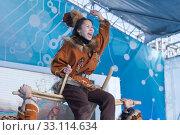 Aborigine female emotional dancing in national clothes indigenous people Kamchatka. Kamchatka Peninsula State Academic Koryak National Dance Ensemble Mengo (2019 год). Редакционное фото, фотограф А. А. Пирагис / Фотобанк Лори