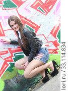 Купить «girl in front of grafitti», фото № 33114834, снято 17 февраля 2020 г. (c) PantherMedia / Фотобанк Лори