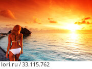 Купить «Woman at water villa at Maldives island», фото № 33115762, снято 18 сентября 2011 г. (c) Иван Михайлов / Фотобанк Лори