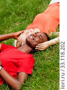 Купить «young enamored multicultural couple in a meadow», фото № 33118202, снято 25 мая 2020 г. (c) PantherMedia / Фотобанк Лори