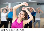 Купить «Young woman enjoying active dances», фото № 33125790, снято 17 февраля 2020 г. (c) Яков Филимонов / Фотобанк Лори