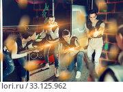 Купить «Jolly people aiming laser guns at other players», фото № 33125962, снято 23 февраля 2020 г. (c) Яков Филимонов / Фотобанк Лори