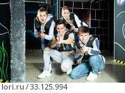 Group of adult people with laser guns having fun on dark lasertag arena. Стоковое фото, фотограф Яков Филимонов / Фотобанк Лори