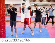 Positive people practicing at kickboxing. Стоковое фото, фотограф Яков Филимонов / Фотобанк Лори