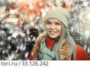 Купить «Girl choosing Christmas gifts outdoor on street market», фото № 33126242, снято 1 декабря 2018 г. (c) Яков Филимонов / Фотобанк Лори