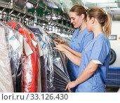 Купить «Two adult women of laundry during daily work», фото № 33126430, снято 9 мая 2018 г. (c) Яков Филимонов / Фотобанк Лори