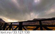 Купить «Timelapse of wooden fence on high terrace at mountain landscape with clouds. Horizontal slider movement», видеоролик № 33127130, снято 18 марта 2018 г. (c) Александр Маркин / Фотобанк Лори
