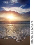 Купить «Sunset over the sea and the foam of the surf breaks on the sandy shore», фото № 33127678, снято 5 февраля 2010 г. (c) Куликов Константин / Фотобанк Лори