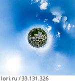 Купить «Aerial city view with crossroads and roads, houses, buildings, parks and parking lots. Sunny summer panoramic image», фото № 33131326, снято 29 марта 2020 г. (c) Александр Маркин / Фотобанк Лори
