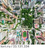 Купить «Aerial city view with crossroads and roads, houses, buildings, parks and parking lots. Sunny summer panoramic image», фото № 33131334, снято 29 марта 2020 г. (c) Александр Маркин / Фотобанк Лори
