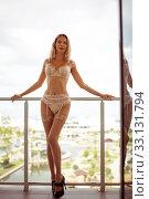 Beautiful sexy woman in elegant stylish expensive lace underwear posing on the balcony. Стоковое фото, фотограф katalinks / Фотобанк Лори