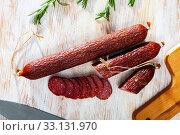 Купить «Smoked sausage with rosemary», фото № 33131970, снято 3 апреля 2020 г. (c) Яков Филимонов / Фотобанк Лори