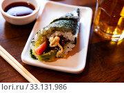 Купить «Temaki with tuna and avocado», фото № 33131986, снято 20 февраля 2020 г. (c) Яков Филимонов / Фотобанк Лори