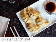 Купить «Japanese tasty dumplings gyozas with soy sauce», фото № 33131994, снято 6 июня 2020 г. (c) Яков Филимонов / Фотобанк Лори