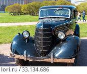 Купить «ГАЗ М-1, «Эмка» — советский легковой автомобиль, серийно производившийся на Горьковском автомобильном заводе», эксклюзивное фото № 33134686, снято 1 мая 2019 г. (c) Александр Щепин / Фотобанк Лори
