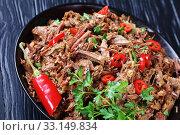 Купить «close-up of spicy pulled beef in a bowl», фото № 33149834, снято 5 ноября 2019 г. (c) Oksana Zh / Фотобанк Лори