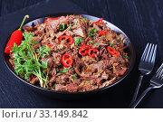 Купить «close-up of juicy pulled beef, top view», фото № 33149842, снято 5 ноября 2019 г. (c) Oksana Zh / Фотобанк Лори