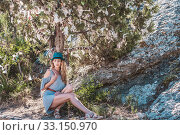 Купить «A tree for tourists in the Genoese fortress in Crimea with branches decorated with knotted fabric ribbons», фото № 33150970, снято 22 июля 2016 г. (c) katalinks / Фотобанк Лори
