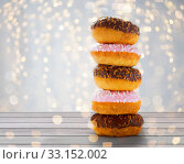 close up of glazed donuts with sprinkles. Стоковое фото, фотограф Syda Productions / Фотобанк Лори