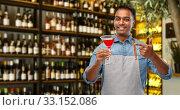 Купить «indian barman with glass of cocktail at bar», фото № 33152086, снято 17 ноября 2019 г. (c) Syda Productions / Фотобанк Лори