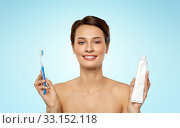 Купить «smiling woman with toothbrush cleaning teeth», фото № 33152118, снято 30 ноября 2019 г. (c) Syda Productions / Фотобанк Лори