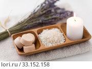 Купить «sea salt, soap, candle and lavender on bath towel», фото № 33152158, снято 8 ноября 2018 г. (c) Syda Productions / Фотобанк Лори
