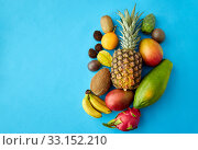 Купить «many different exotic fruits on blue background», фото № 33152210, снято 16 ноября 2018 г. (c) Syda Productions / Фотобанк Лори