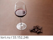 Купить «dark chocolate pieces and glass of red wine», фото № 33152246, снято 1 февраля 2019 г. (c) Syda Productions / Фотобанк Лори