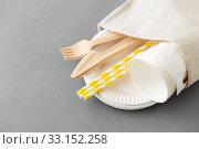 Купить «wooden forks, knives, paper straws and cups», фото № 33152258, снято 3 мая 2019 г. (c) Syda Productions / Фотобанк Лори