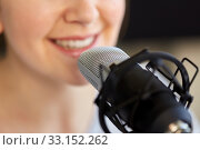 Купить «close up of woman talking to microphone», фото № 33152262, снято 17 мая 2019 г. (c) Syda Productions / Фотобанк Лори