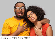 Купить «happy african american couple in glasses hugging», фото № 33152282, снято 15 декабря 2019 г. (c) Syda Productions / Фотобанк Лори